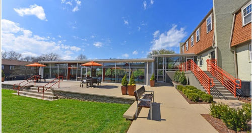 Open courtyard with gardens and picnic seating.